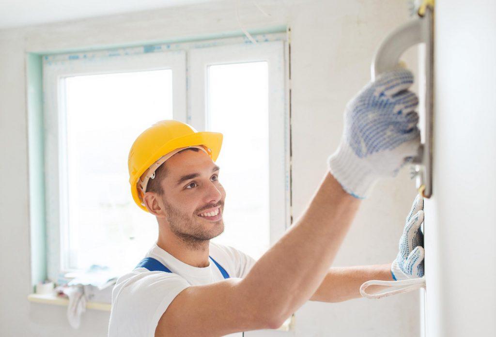construction man refinishing the wall